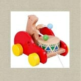 Xe con thỏ gõ trống. Bằng gỗ sơn màu.  Size: 16 x 12 x 16 cm
